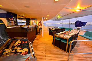 Outdoors dining area - Celebrity Xploration - Galapagos Liveaboards - Dive Discovery Galapagos